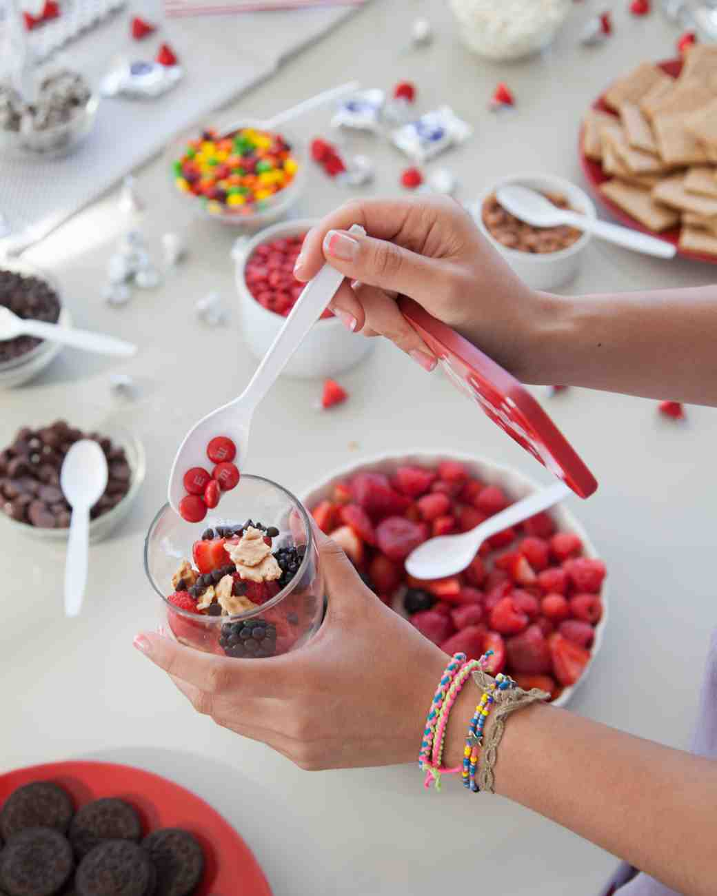 retro-ice-cream-parlor-bridal-shower-guest-adding-toppings-0815_vert